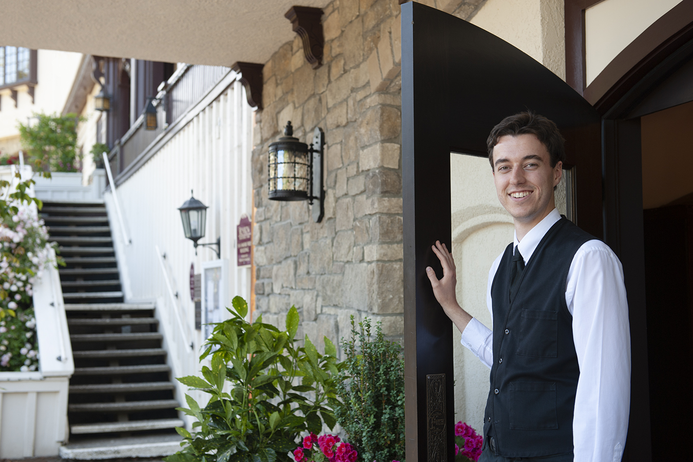 banner image is of Guest attendant opens the lobby door, welcome to Benbow Historic Inn