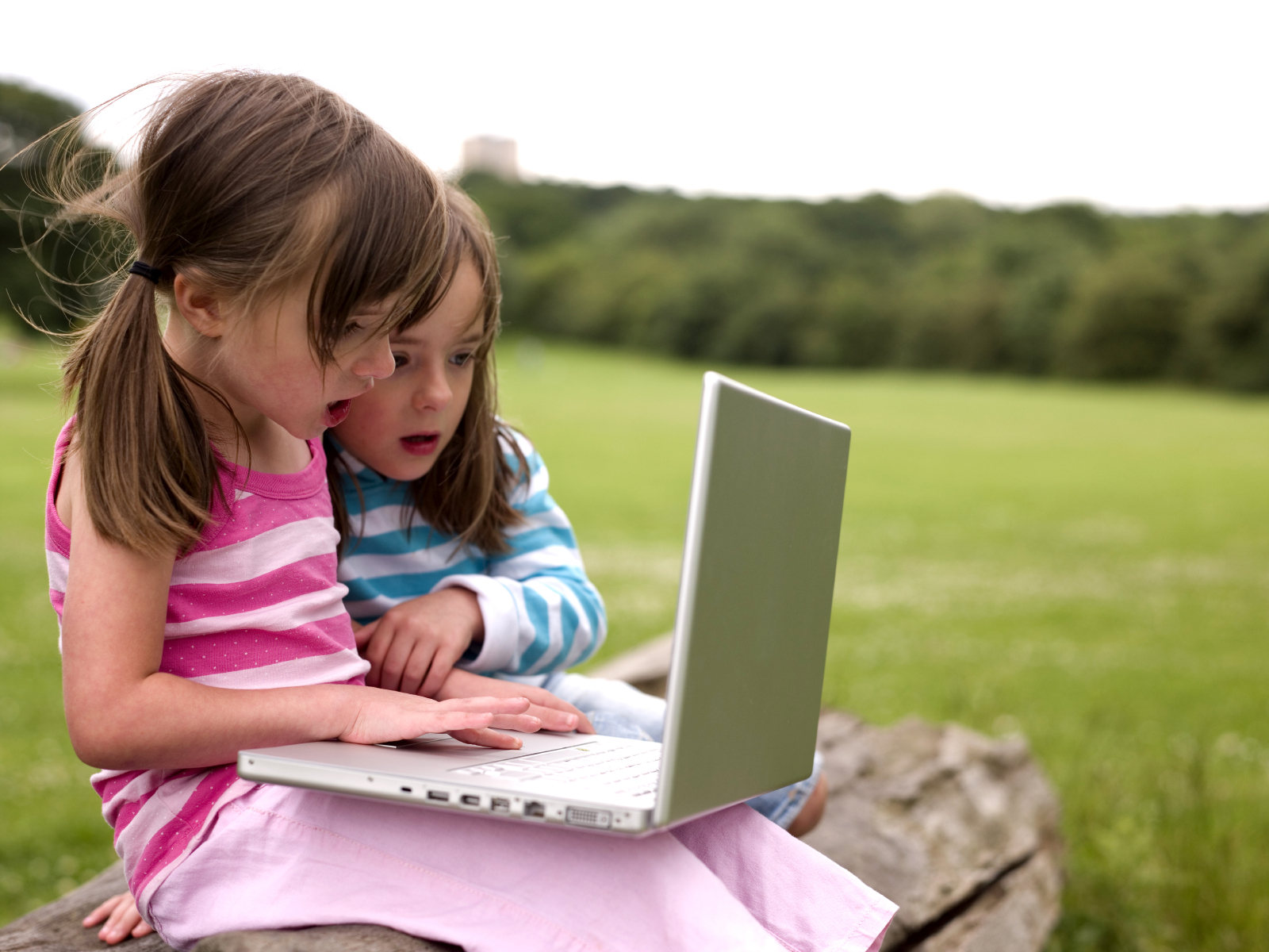banner image is of Two girls looking at a computer
