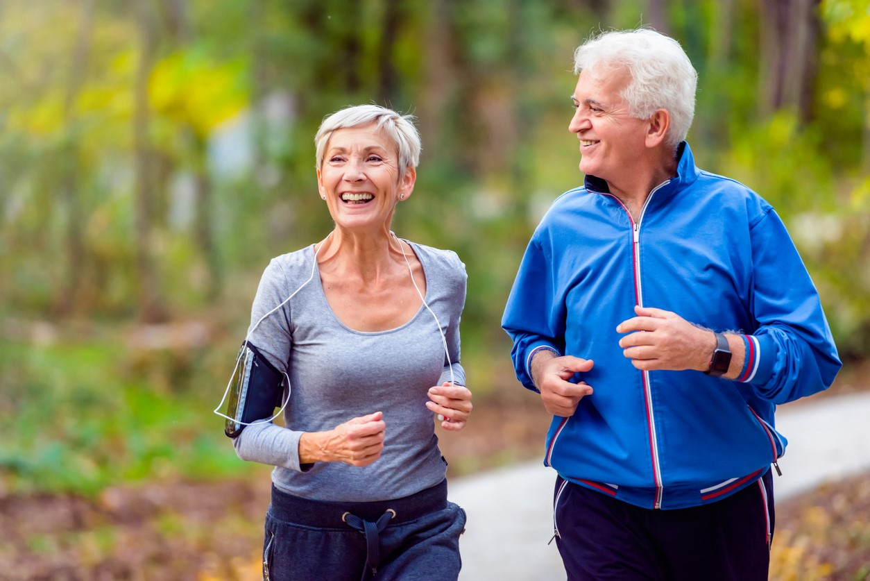 banner image is of Older male and female exercising outdoors