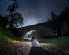 Couple kissing under the stars in front of the Benbow Bridge